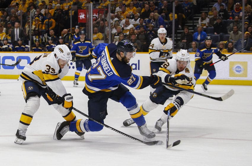 NASHVILLE, TENNESSEE - FEBRUARY 16: Alex Pietrangelo #27 of the St. Louis Blues takes a shot past Ryan Johansen #92 of the Nashville Predators during the second period at Bridgestone Arena on February 16, 2020 in Nashville, Tennessee. (Photo by Frederick Breedon/Getty Images)