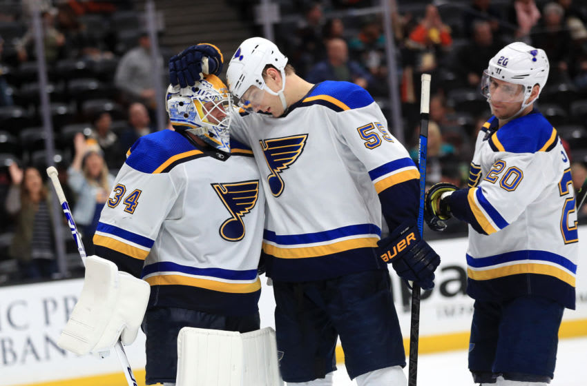 ANAHEIM, CALIFORNIA - MARCH 11: Alexander Steen #20 and Colton Parayko #55 congratulate Jake Allen #34 of the St. Louis Blues after defeating the Anaheim Ducks 4-2 in a game at Honda Center on March 11, 2020 in Anaheim, California. (Photo by Sean M. Haffey/Getty Images)
