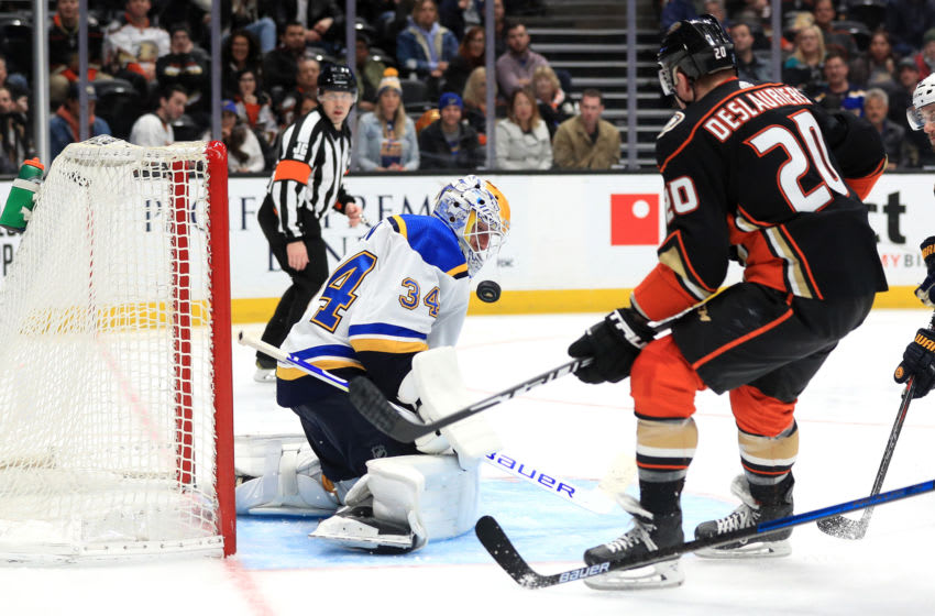 ANAHEIM, CALIFORNIA - MARCH 11: Jake Allen #34 of the St. Louis Blues blocks a shot on goal as Nicolas Deslauriers #20 of the Anaheim Ducks rushes the puck during the third period of a game at Honda Center on March 11, 2020 in Anaheim, California. (Photo by Sean M. Haffey/Getty Images)