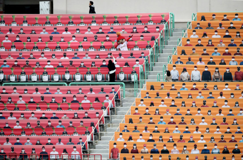 INCHEON, SOUTH KOREA - MAY 05: (EDITORIAL USE ONLY) The stands at SK Wyverns club's Happy Dream Ballpark, are filled with placards featuring their fans during the Korean Baseball Organization (KBO) League opening game between SK Wyverns and Hanwha Eagles at the empty SK Happy Dream Ballpark on May 05, 2020 in Incheon, South Korea. The 2020 KBO season started after being delayed from the original March 28 Opening Day due to the coronavirus (COVID-19) outbreak. The KBO said its 10 clubs will be able to expand their rosters from 28 to 33 players in 54 games this season, up from the usual 26. Teams are scheduled to play 144 games this year. As they prepared for the new beginning, 10 teams managers said the season would not be happening without the hard work and dedication of frontline medical and health workers. South Korea is transiting this week to a quarantine scheme that allows citizens to return to their daily routines under eased guidelines. But health authorities are still wary of