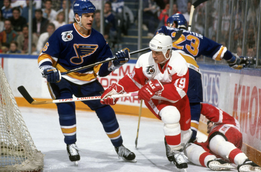 DETROIT, MI - CIRCA 1992: Steve Yzerman #19 of the Detroit Redwings skates against the St. Louis Blues during an NHL Hockey game circa 1992 at the Joe Louis Arena in Detroit, Michigan. Yzerman's playing career went from 1983-2006. (Photo by Focus on Sport/Getty Images)