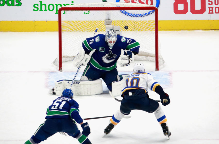 EDMONTON, ALBERTA - AUGUST 16: Brayden Schenn #10 of the St. Louis Blues scores the game winning goal at 15:06 of overtime against Jacob Markstrom #25 of the Vancouver Canucks in Game Four of the Western Conference First Round during the 2020 NHL Stanley Cup Playoffs at Rogers Place on August 16, 2020 in Edmonton, Alberta, Canada. The Blues defeated the Canucks 3-2 in overtime. (Photo by Jeff Vinnick/Getty Images)