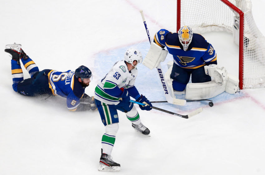EDMONTON, ALBERTA - AUGUST 19: Jake Allen #34 of the St. Louis Blues makes the first period save on Bo Horvat #53 of the Vancouver Canucks in Game Five of the Western Conference First Round during the 2020 NHL Stanley Cup Playoffs at Rogers Place on August 19, 2020 in Edmonton, Alberta, Canada. (Photo by Jeff Vinnick/Getty Images)