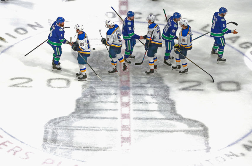 EDMONTON, ALBERTA - AUGUST 21: The St. Louis Blues and the Vancouver Canucks shake hands following their Game Six of the Western Conference First Round during the 2020 NHL Stanley Cup Playoffs at Rogers Place on August 21, 2020 in Edmonton, Alberta, Canada. The Canucks defeated the Blues 6-2 to win the Round One playoff series 4-2. (Photo by Jeff Vinnick/Getty Images)