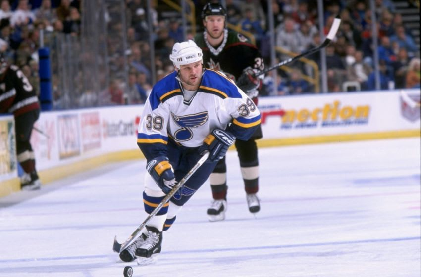 14 Mar 1998: Kelly Chase #39 of the St. Louis Blues stick handles the puck during a game against the Phoenix Coyotes at the Kiel Center in St. Louis, Missouri. The Coyotes defeated the Blues 2-0.