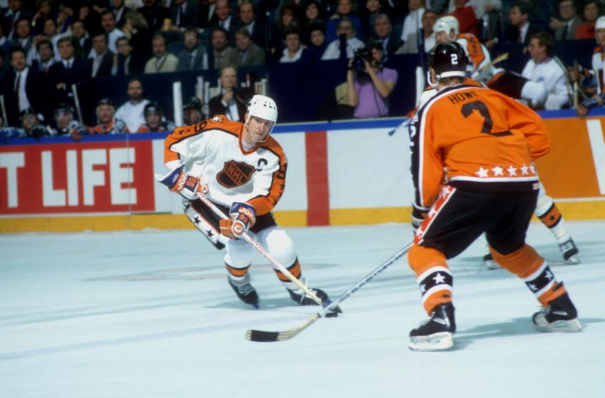 ST. LOUIS, MO - FEBRUARY 9: Wayne Gretzky #99 of the Campbell Conference and the Edmonton Oilers skates with the puck as he is defended by Mark Howe #2 of the Wales Conference and the Philadelphia Flyers during the 1988 39th NHL All-Star Game on February 9, 1988 at the St. Louis Arena in St. Louis, Missouri. The Wales Conference defeated the Campbell Conference 6-5. (Photo by B Bennett/Getty Images)