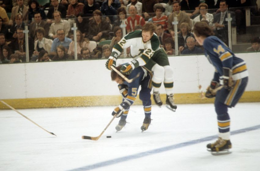 BLOOMINGTON, MN - APRIL, 1972: Bob Plager #5 of the St. Louis Blues checks Dennis Hextall #22 of the Minnesota North Stars during the 1972 Quarter-Finals in April, 1972 at the Met Center in Bloomington, Minnesota. (Photo by Melchior DiGiacomo/Getty Images)