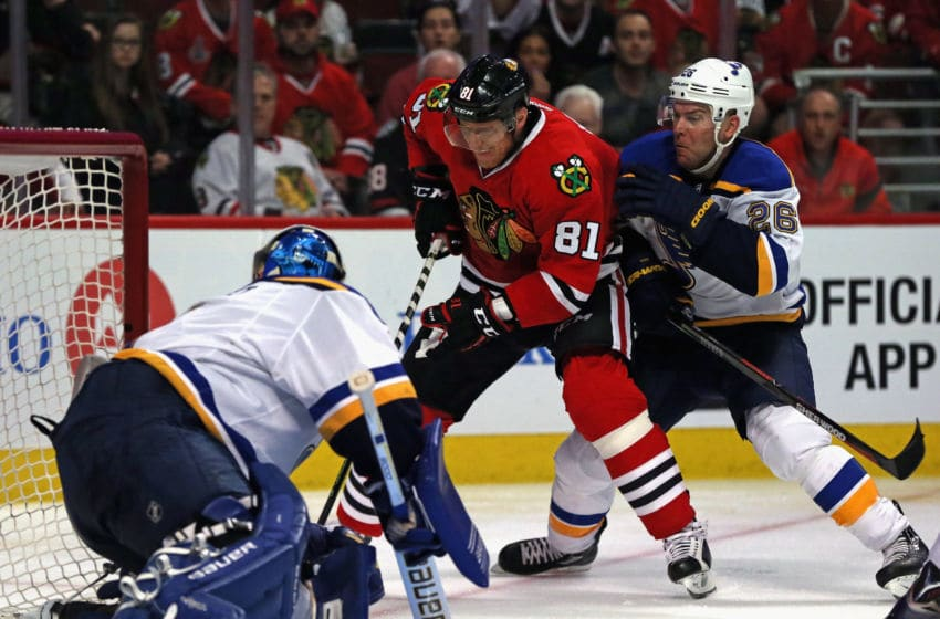 CHICAGO, IL - APRIL 17: Marian Hossa #81 of the Chicago Blackhawks tries to get off a shot at Brian Elliott #1 of the St. Louis Blues under pressure from Paul Stastny #26 in Game Three of the Western Conference Quarterfinals during the 2016 NHL Stanley Cup Playoffs at the United Center on April 5, 2016 in Chicago, Illinois. The Blues defeated the Blackhawkss 3-2.(Photo by Jonathan Daniel/Getty Images)