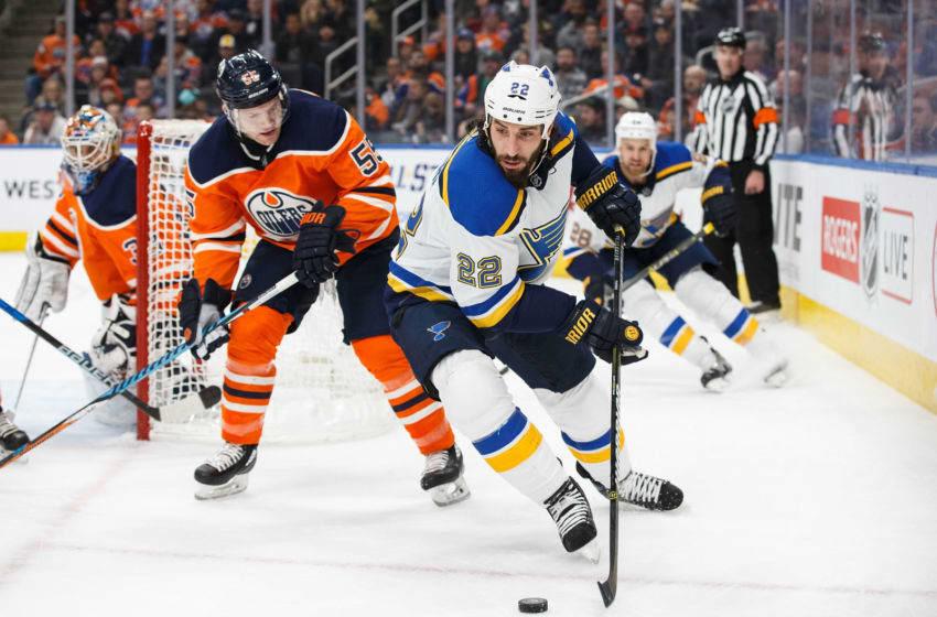 EDMONTON, AB - DECEMBER 21: Mark Letestu #55 of the Edmonton Oilers keeps an eye on Chris Thorburn #22 of the St. Louis Blues at Rogers Place on December 21, 2017 in Edmonton, Canada. (Photo by Codie McLachlan/Getty Images)