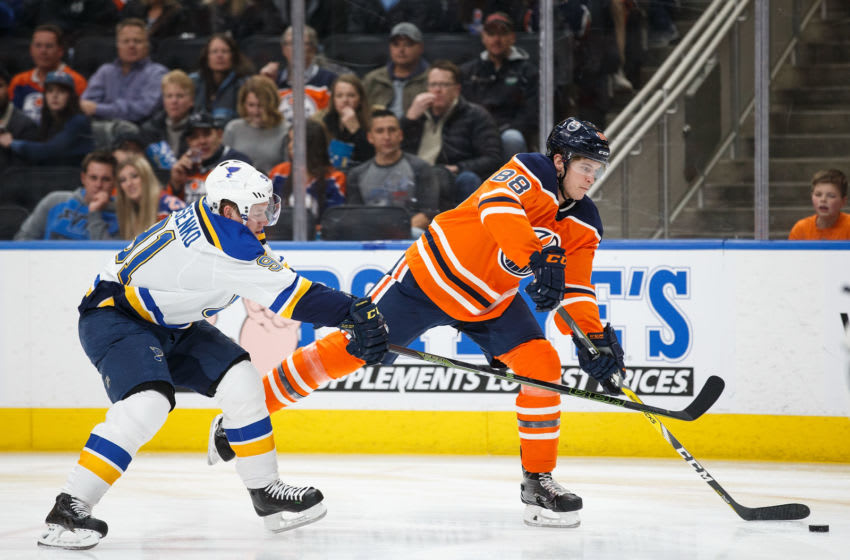 EDMONTON, AB - DECEMBER 21: Brandon Davidson #88 of the Edmonton Oilers is pursued by Vladimir Tarasenko #91 of the St. Louis Blues at Rogers Place on December 21, 2017 in Edmonton, Canada. (Photo by Codie McLachlan/Getty Images)