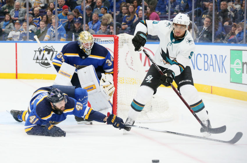 The St. Louis Blues' Robert Bortuzzo (41) tries to prevent a pass to the San Jose Sharks' Evander Kane in the second period on Tuesday, March 27, 2018, at the Scottrade Center in St. Louis. Also defending on the play is Blues goaltender Jake Allen. The Blues won, 3-2, in overtime. (Chris Lee/St. Louis Post-Dispatch/TNS via Getty Images)