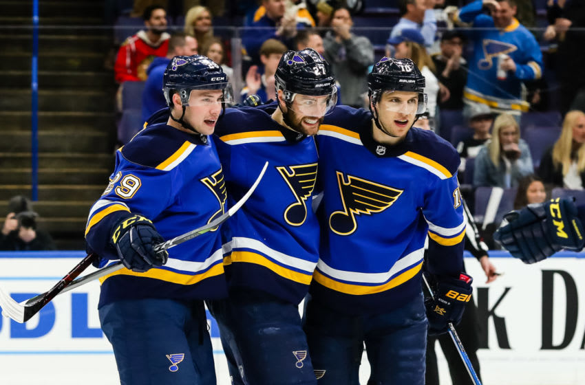 ST. LOUIS, MO - APRIL 04: St. Louis Blues' Brayden Schenn, right, is congratulated after scoring a goal by Alex Pietrangelo, center, and Vince Dunn, left, during the second period of an NHL hockey game between the St. Louis Blues and the Chicago Blackhawks on April 4, 2018, at Scottrade Center in St. Louis, MO. (Photo by Tim Spyers/Icon Sportswire via Getty Images)