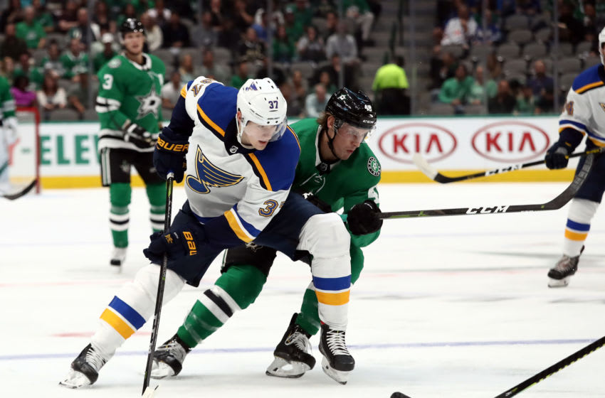 DALLAS, TEXAS - SEPTEMBER 16: Klim Kostin #37 of the St. Louis Blues and Rhett Gardner #49 of the Dallas Stars during a NHL preseason game at American Airlines Center on September 16, 2019 in Dallas, Texas. (Photo by Ronald Martinez/Getty Images)