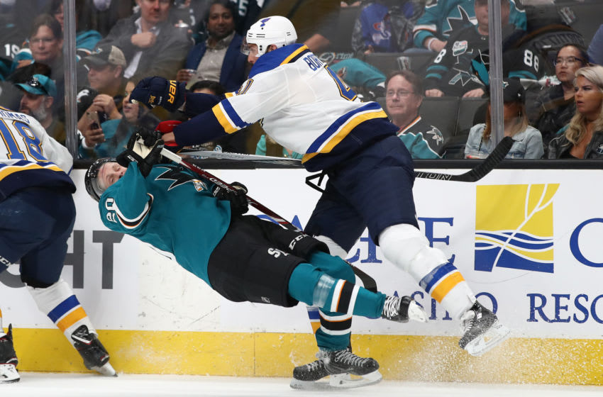 SAN JOSE, CALIFORNIA - MAY 13: Marcus Sorensen #20 of the San Jose Sharks is hit by Robert Bortuzzo #41 of the St. Louis Blues in Game Two of the Western Conference Final during the 2019 NHL Stanley Cup Playoffs at SAP Center on May 13, 2019 in San Jose, California. (Photo by Ezra Shaw/Getty Images)
