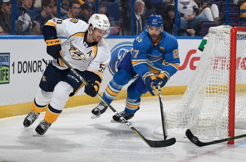 ST. LOUIS, MO - APRIL 2: Roman Josi #59 of the Nashville Predators skates shoots the puck as Alex Pietrangelo #27 of the St. Louis Blues defends during the game on April 2, 2017 at Scottrade Center in St. Louis, Missouri. (Photo by Scott Rovak/NHLI via Getty Images)