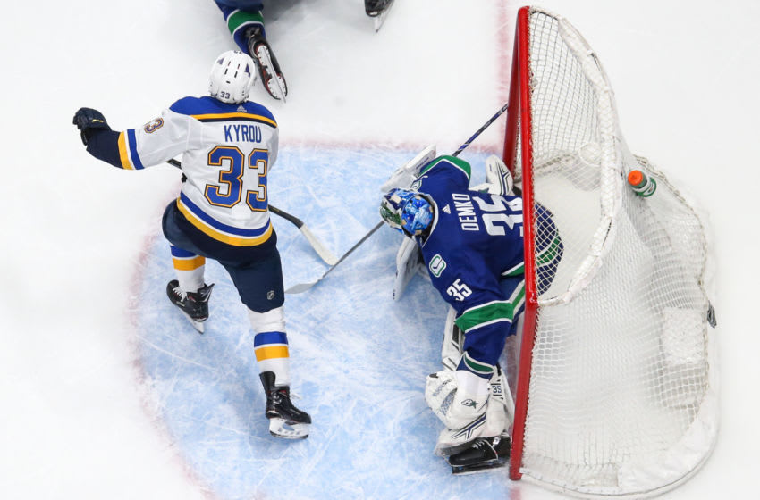 VANCOUVER, BC - JANUARY 27: St. Louis Blues Right Wing Jordan Kyrou (33) skates through the goal crease in front of Vancouver Canucks Goalie Thatcher Demko (35) during their NHL game at Rogers Arena on January 27, 2020 in Vancouver, British Columbia, Canada. (Photo by Devin Manky/Icon Sportswire via Getty Images)