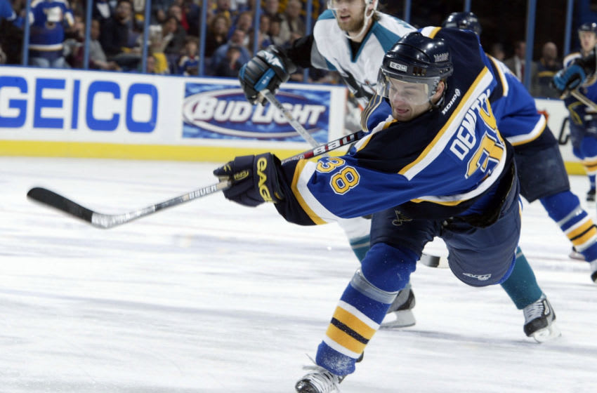 ST. LOUIS - APRIL 12: Pavol Demitra #38 of the St. Louis Blues takes a shot during a power play in the first period against the San Jose Sharks on April 12, 2004 at the Savvis Center in St. Louis, Missouri. (Photo by Elsa/Getty Images)