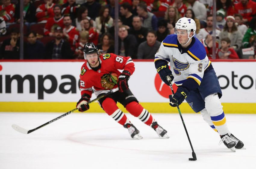 CHICAGO, ILLINOIS - MARCH 08: Sammy Blais #9 of the St. Louis Blues looks to pass chased by Alex Nylander #92 of the Chicago Blackhawks at the United Center on March 08, 2020 in Chicago, Illinois. (Photo by Jonathan Daniel/Getty Images)