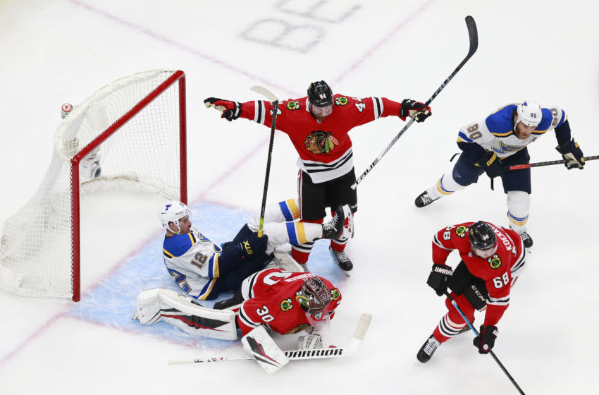 EDMONTON, ALBERTA - JULY 29: Zach Sanford #12 of the St. Louis Blues falls into Malcolm Subban #30 of the Chicago Blackhawks during the third period in an exhibition game prior to the 2020 NHL Stanley Cup Playoffs at Rogers Place on July 29, 2020 in Edmonton, Alberta. (Photo by Jeff Vinnick/Getty Images)