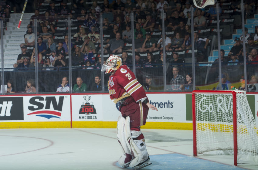 REGINA, SK - MAY 27: Evan Fitzpatrick #31 of Acadie-Bathurst Titan throws his stick and gloves in the air at the buzzer signifying the Memorial Cup win against the Regina Pats at Brandt Centre - Evraz Place on May 27, 2018 in Regina, Canada. (Photo by Marissa Baecker/Getty Images)
