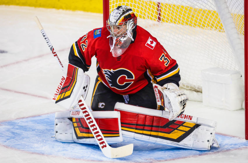 Sep 18, 2019; Calgary, Alberta, CAN; Calgary Flames goaltender Jon Gillies (32) guards his net against the San Jose Sharks during the third period at Scotiabank Saddledome. Calgary Flames won 6-4. Mandatory Credit: Sergei Belski-USA TODAY Sports