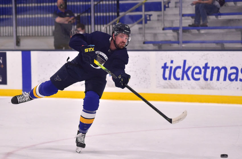 Jul 14, 2020; St. Louis, Missouri, USA; St. Louis Blues left wing Zach Sanford (12) shoots during a NHL workout at Centene Community Ice Center. Mandatory Credit: Jeff Curry-USA TODAY Sports