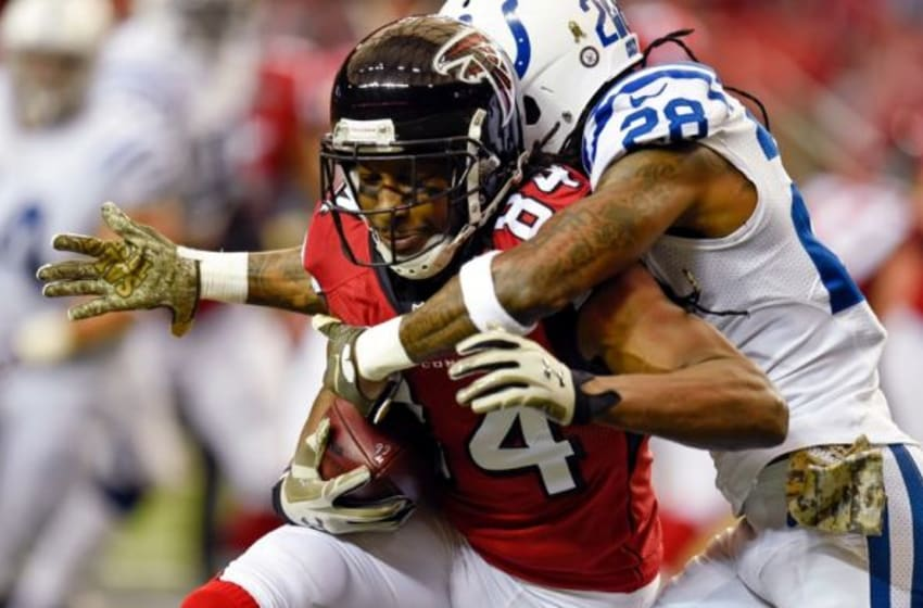 Nov 22, 2015; Atlanta, GA, USA; Atlanta Falcons wide receiver Roddy White (84) is tackled by Indianapolis Colts cornerback Greg Toler (28) during the first quarter at the Georgia Dome. Mandatory Credit: Dale Zanine-USA TODAY Sports