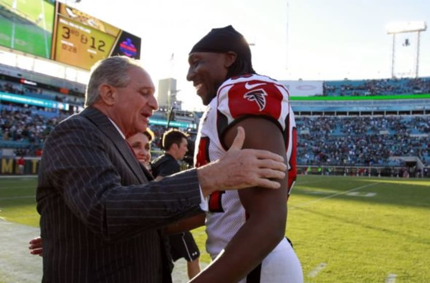 Dec 20, 2015; Jacksonville, FL, USA; Atlanta Falcons wide receiver Roddy White (84) hugs owner Arthur Blank as they beat the Jacksonville Jaguars during the second half at EverBank Field. Atlanta Falcons defeated the Jacksonville Jaguars 23-17. Mandatory Credit: Kim Klement-USA TODAY Sports