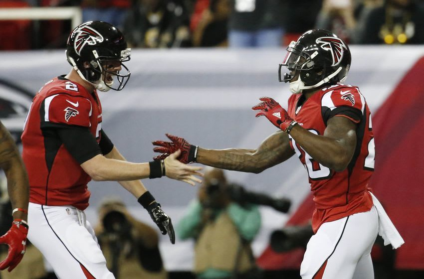 Jan 1, 2017; Atlanta, GA, USA; Atlanta Falcons running back Tevin Coleman (26, right) celebrates his touchdown with quarterback Matt Ryan (2) in the first quarter of their game against the New Orleans Saints at the Georgia Dome. The Falcons won 38-32. Mandatory Credit: Jason Getz-USA TODAY Sports