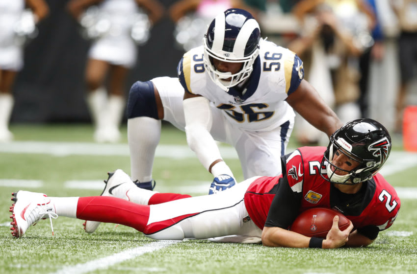 ATLANTA, GA - OCTOBER 20: Matt Ryan #2 of the Atlanta Falcons is sacked by Dante Fowler #56 of the Los Angeles Rams in the first half of an NFL game at Mercedes-Benz Stadium on October 20, 2019 in Atlanta, Georgia. (Photo by Todd Kirkland/Getty Images)