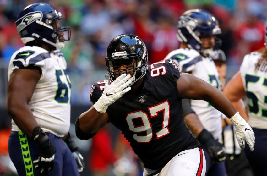ATLANTA, GEORGIA - OCTOBER 27: Grady Jarrett #97 of the Atlanta Falcons reacts after sacking Russell Wilson #3 of the Seattle Seahawks in the second half at Mercedes-Benz Stadium on October 27, 2019 in Atlanta, Georgia. (Photo by Kevin C. Cox/Getty Images)
