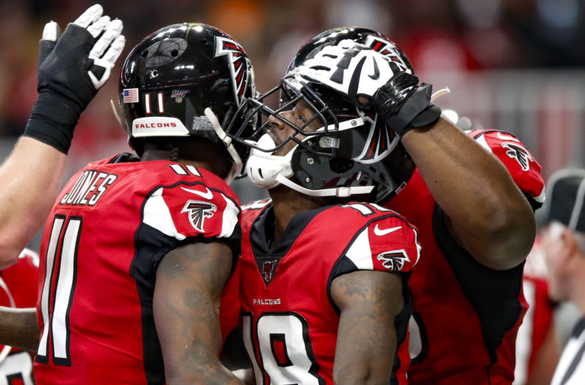 ATLANTA, GA - DECEMBER 08: Calvin Ridley #18 of the Atlanta Falcons reacts with teammates after a touchdown in the first half on an NFL game against the Carolina Panthers at Mercedes-Benz Stadium on December 8, 2019 in Atlanta, Georgia. (Photo by Todd Kirkland/Getty Images)