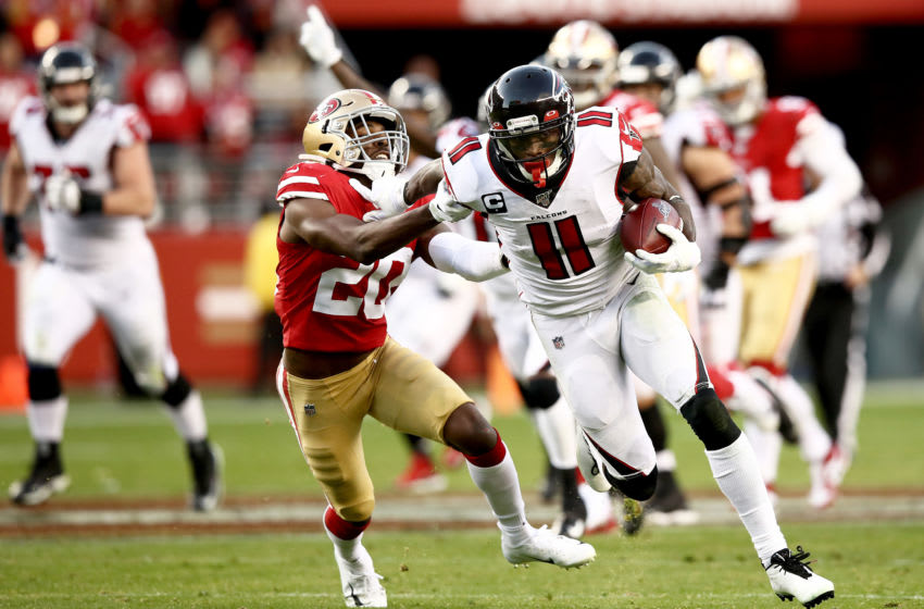 SANTA CLARA, CALIFORNIA - DECEMBER 15: Wide receiver Julio Jones #11 of the Atlanta Falcons carries the ball against free safety Jimmie Ward #20 of the San Francisco 49ers during the game at Levi's Stadium on December 15, 2019 in Santa Clara, California. (Photo by Ezra Shaw/Getty Images)