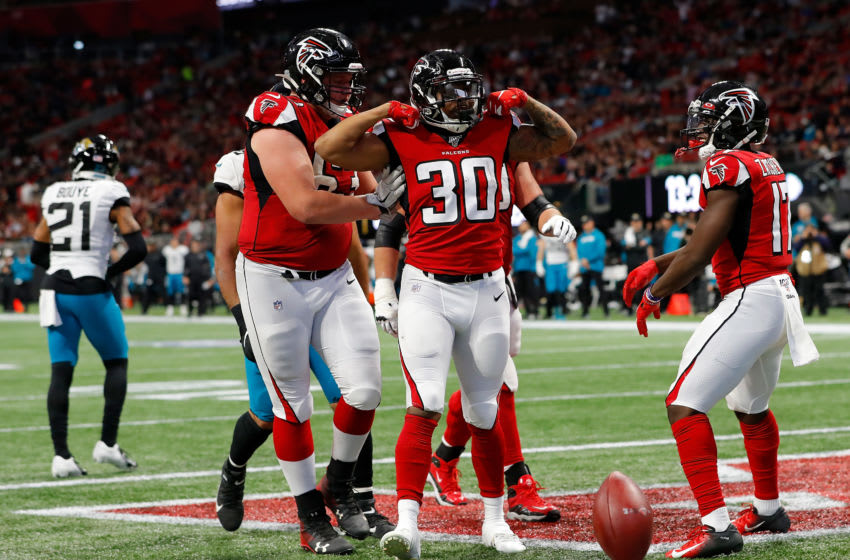 ATLANTA, GEORGIA - DECEMBER 22: Qadree Ollison #30 of the Atlanta Falcons reacts after rushing for a touchdown against the Jacksonville Jaguars in the second half at Mercedes-Benz Stadium on December 22, 2019 in Atlanta, Georgia. (Photo by Kevin C. Cox/Getty Images)