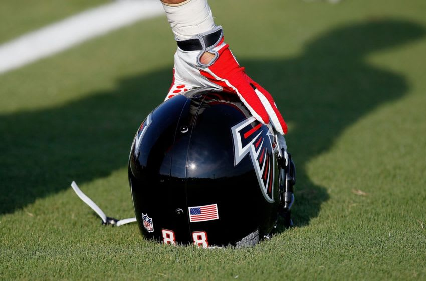 FLOWERY BRANCH, GA - JULY 30: Tony Gonzalez #88 of the Atlanta Falcons leans on his helmet during stretches before opening day of training camp on July 30, 2010 at the Falcons Training Complex in Flowery Branch, Georgia. (Photo by Kevin C. Cox/Getty Images)
