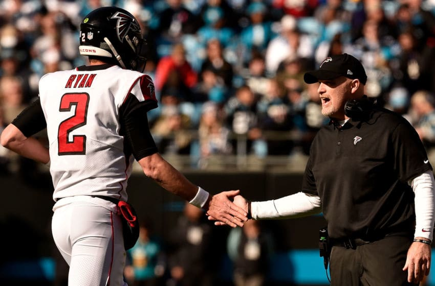 CHARLOTTE, NORTH CAROLINA - DECEMBER 23: Head coach Dan Quinn greets Matt Ryan #2 of the Atlanta Falcons after a play against the Carolina Panthers in the second quarter during their game at Bank of America Stadium on December 23, 2018 in Charlotte, North Carolina. (Photo by Grant Halverson/Getty Images)