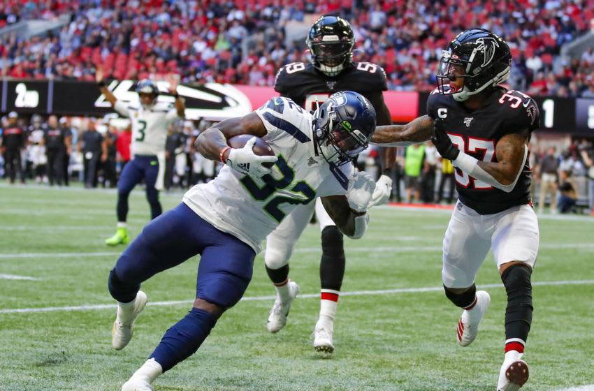 ATLANTA, GA - OCTOBER 27: Chris Carson #32 of the Seattle Seahawks rushes in for a touchdown as Ricardo Allen #37 of the Atlanta Falcons defends in the first half of an NFL game at Mercedes-Benz Stadium on October 27, 2019 in Atlanta, Georgia. (Photo by Todd Kirkland/Getty Images)