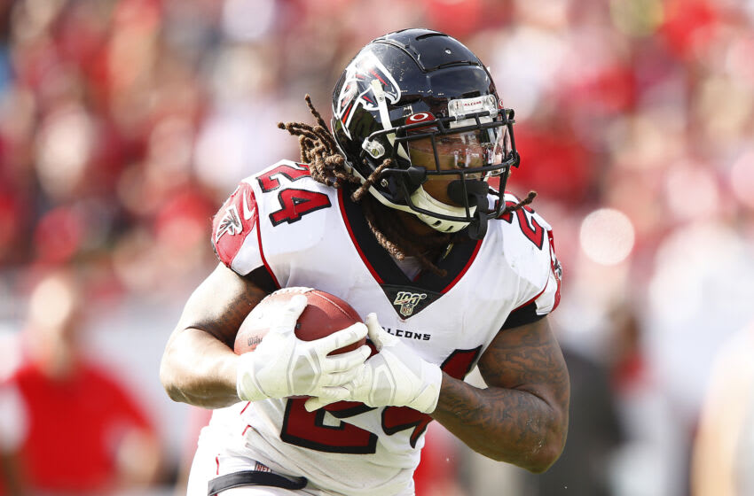 TAMPA, FLORIDA - DECEMBER 29: Devonta Freeman #24 of the Atlanta Falcons in action against the Tampa Bay Buccaneers during the first half at Raymond James Stadium on December 29, 2019 in Tampa, Florida. (Photo by Michael Reaves/Getty Images)
