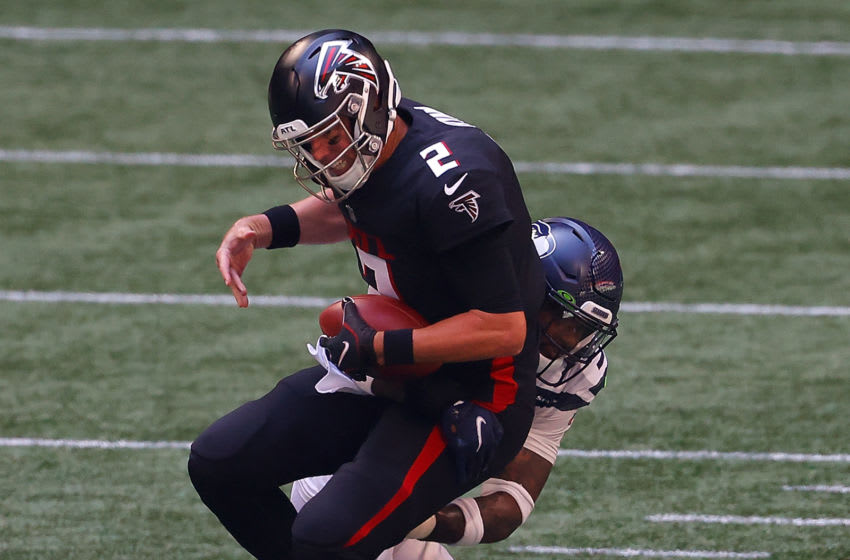 ATLANTA, GEORGIA - SEPTEMBER 13: Matt Ryan #2 of the Atlanta Falcons is sacked by Jamal Adams #33 of the Seattle Seahawks in the first half at Mercedes-Benz Stadium on September 13, 2020 in Atlanta, Georgia. (Photo by Kevin C. Cox/Getty Images)