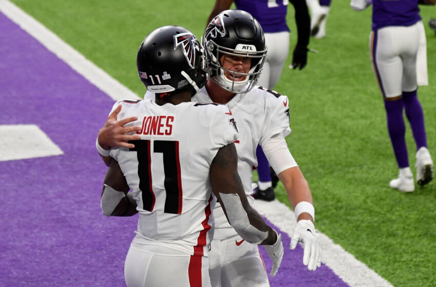 MINNEAPOLIS, MINNESOTA - OCTOBER 18: Julio Jones #11 and Matt Ryan #2 of the Atlanta Falcons celebrate after scoring a touchdown in the first quarter against the Minnesota Vikings at U.S. Bank Stadium on October 18, 2020 in Minneapolis, Minnesota. (Photo by Hannah Foslien/Getty Images)