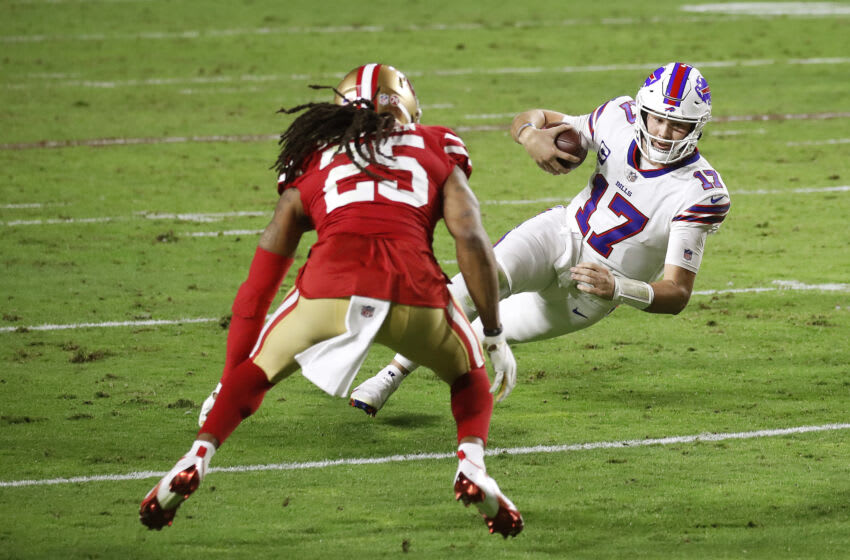 GLENDALE, ARIZONA - DECEMBER 07: Quarterback Josh Allen #17 of the Buffalo Bills scrambles ahead of defender cornerback Richard Sherman #25 of the San Francisco 49ers during the second quarter of a game at State Farm Stadium on December 07, 2020 in Glendale, Arizona. (Photo by Christian Petersen/Getty Images)