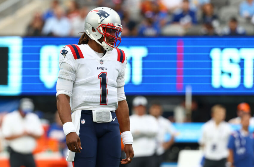 EAST RUTHERFORD, NEW JERSEY - AUGUST 29: Cam Newton #1 of the New England Patriots looks on during the game against the New York Giants at MetLife Stadium on August 29, 2021 in East Rutherford, New Jersey. (Photo by Mike Stobe/Getty Images)
