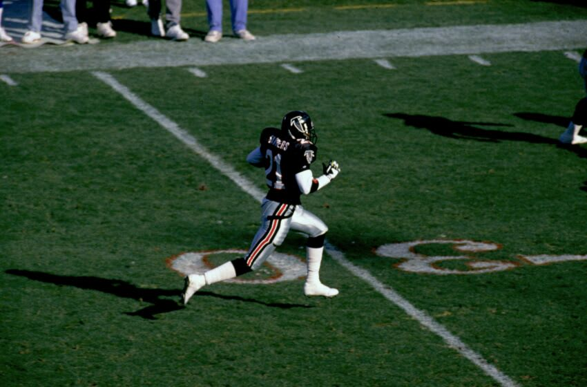 ATLANTA, GA - DECEMBER 15: Deion Sanders #21 of the Atlanta Falcons returns a lateral from an interception against the Seattle Seahawks in an NFL game at the Fulton County Stadium on December 15, 1991 in Atlanta, Georgia. The Falcons defeated the Seahawks 26-13. (Photo by Gin Ellis/Getty Images)