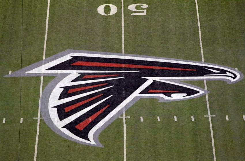 ATLANTA, GA - JANUARY 15: A detail of the Atlanta Falcons logo is seen at the 50 yard line against the Green Bay Packers during their 2011 NFC divisional playoff game at Georgia Dome on January 15, 2011 in Atlanta, Georgia. (Photo by Kevin C. Cox/Getty Images)
