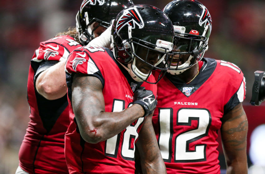 ATLANTA, GA - SEPTEMBER 15: Calvin Ridley #18 celebrates with Mohamed Sanu #12 of the Atlanta Falcons following his reception for a touchdown during the first half of a game against the Philadelphia Eagles at Mercedes-Benz Stadium on September 15, 2019 in Atlanta, Georgia. (Photo by Carmen Mandato/Getty Images)