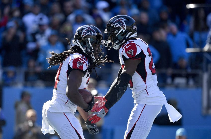 CHARLOTTE, NORTH CAROLINA - NOVEMBER 17: Desmond Trufant #21 celebrates with Damontae Kazee #27 of the Atlanta Falcons after intercepting a pass against the Carolina Panthers during the second quarter of their game at Bank of America Stadium on November 17, 2019 in Charlotte, North Carolina. (Photo by Grant Halverson/Getty Images)