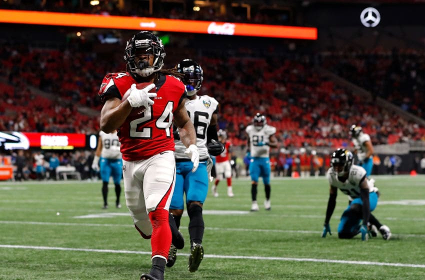 ATLANTA, GEORGIA - DECEMBER 22: Devonta Freeman #24 of the Atlanta Falcons rushes for a touchdown against the Jacksonville Jaguars in the first quarter at Mercedes-Benz Stadium on December 22, 2019 in Atlanta, Georgia. (Photo by Kevin C. Cox/Getty Images)