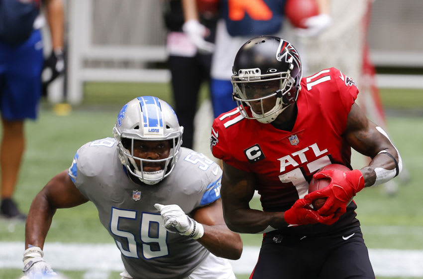 ATLANTA, GEORGIA - OCTOBER 25: Julio Jones #11 of the Atlanta Falcons makes a reception with Reggie Ragland #59 of the Detroit Lions in pursuit during the first half at Mercedes-Benz Stadium on October 25, 2020 in Atlanta, Georgia. (Photo by Kevin C. Cox/Getty Images)