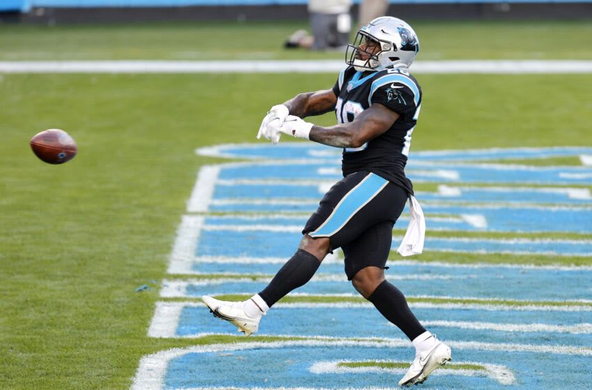 CHARLOTTE, NORTH CAROLINA - DECEMBER 13: Mike Davis #28 of the Carolina Panthers scores a 10-yard rushing touchdown against the Denver Broncos during the fourth quarter at Bank of America Stadium on December 13, 2020 in Charlotte, North Carolina. (Photo by Jared C. Tilton/Getty Images)