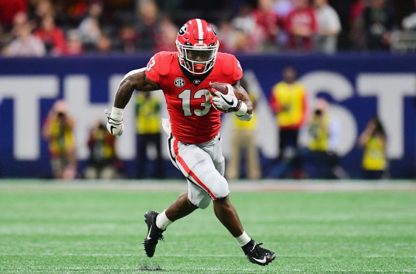 ATLANTA, GA - DECEMBER 01: Elijah Holyfield #13 of the Georgia Bulldogs runs with the ball in the second half against the Alabama Crimson Tide during the 2018 SEC Championship Game at Mercedes-Benz Stadium on December 1, 2018 in Atlanta, Georgia. (Photo by Scott Cunningham/Getty Images)